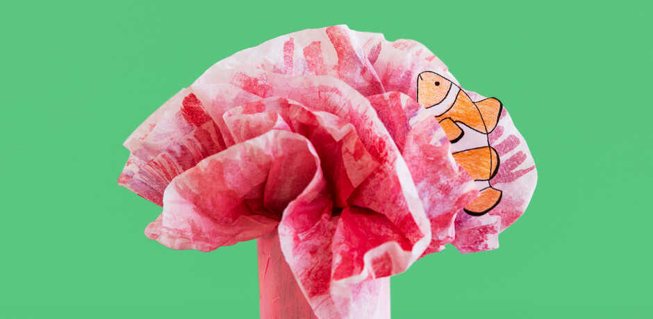 Paper clownfish craft in a tissue paper anemone
