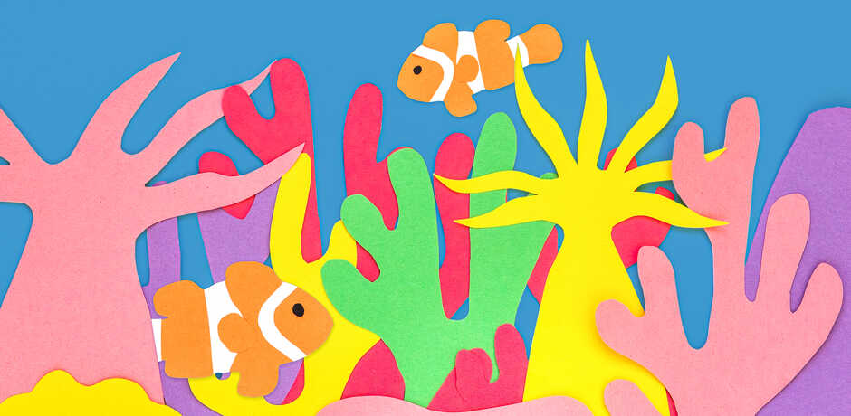 Construction paper coral reef scene with clownfish