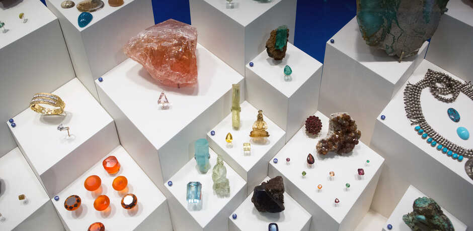 Colorful cut and raw gems and minerals on exhibit at the Academy