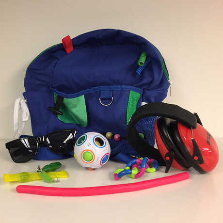 Sensory bags with headphones, sunglasses, and fidget toys
