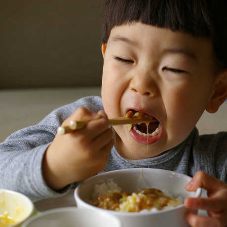 Child Eating with chopsticks