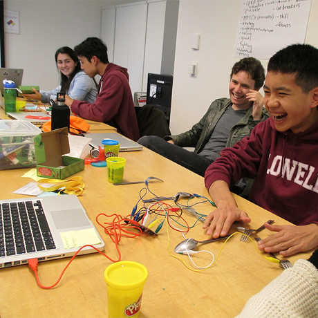Students in the TechTeens program working on a project.