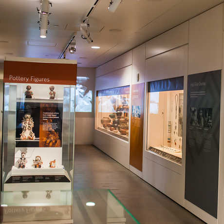 Image of the Evolving Traditions gallery, showcasing pottery, jewelery, and more.