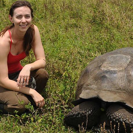 Historian Elizabeth Hennessy with Galápagos tortoise