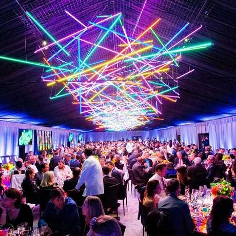 Aerial neon sculpture illuminates diners at Big Bang Gala