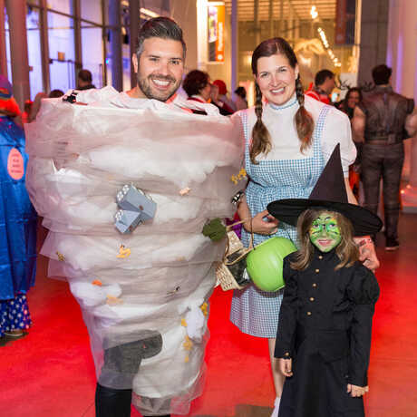Family dressed up in Wizard of Oz costumes