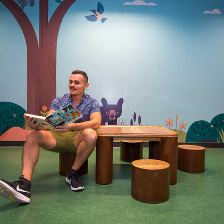 Portrait of illustrator Alexander Vidal, the artist who created the woodland murals in Curiosity Grove.