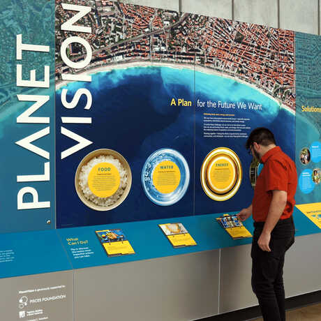 A guest looks at the new PlanetVision exhibit at the California Academy of Sciences