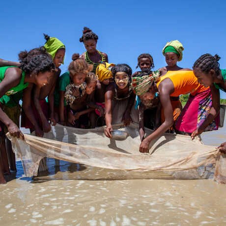 Madagascan girls pose with a fishing net