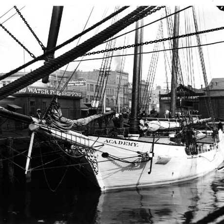 """The Academy"" expedition vessel tied up at dock, circa 1905"