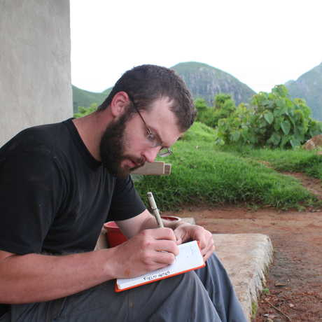 Dave Blackburn in the field taking notes