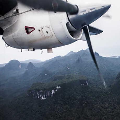 A plane flies over the islands of Sao Tome and Principe