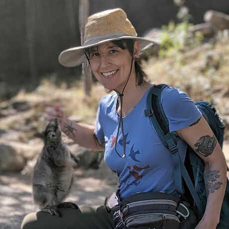 Sarah Crews holds a wallaby