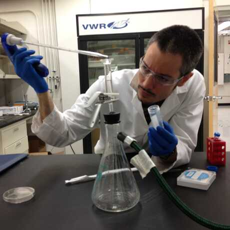 A high school teacher works at a lab over the summer.