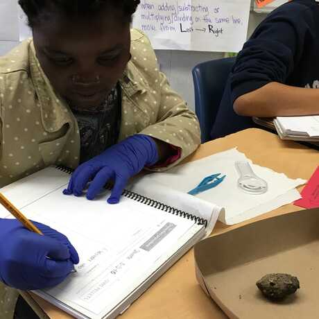 student using science notebook