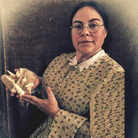 19th century paleontologist Mary Anning holding fossil shells