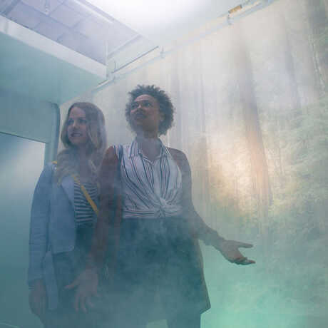 Two guests inside the Fog Room experience