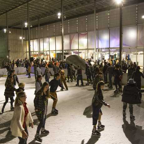 NightLife guests skating at night on the Holiday Ice Rink
