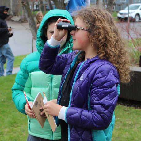 Girl looking through binoculars