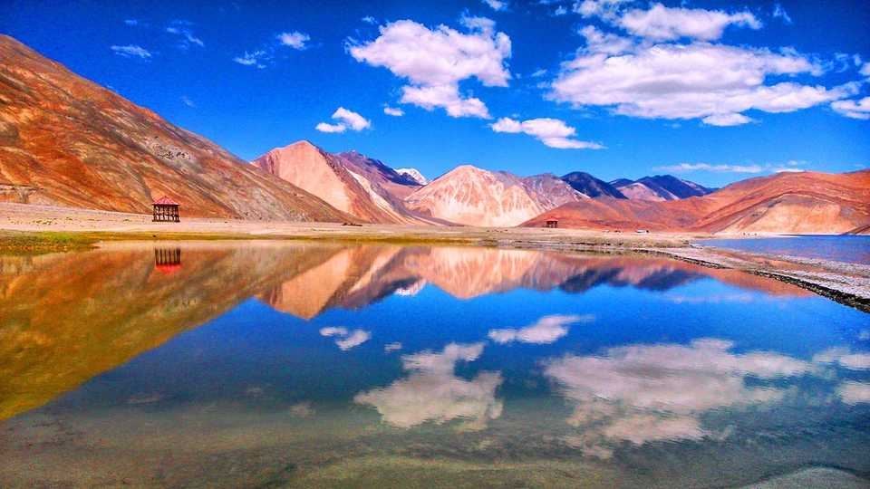 Blue sky with reflective lake